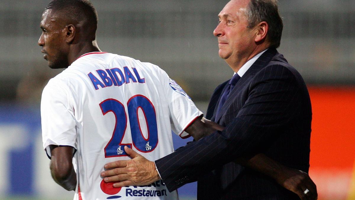 Eric Abidal et Gérard Houiller