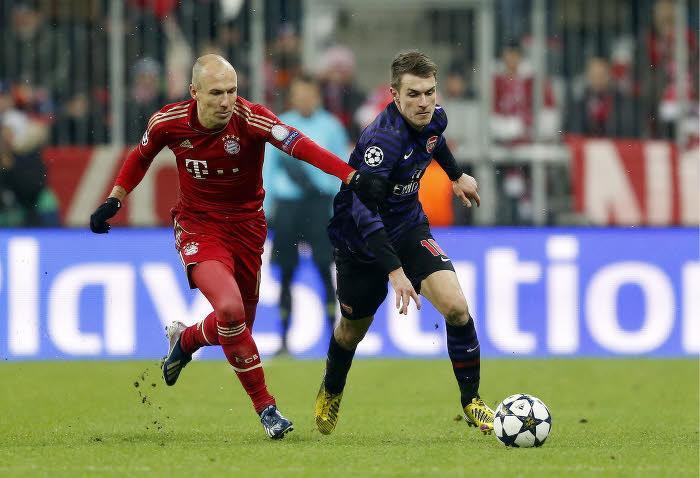Arjen Robben et Aaron Ramsey, en 2013