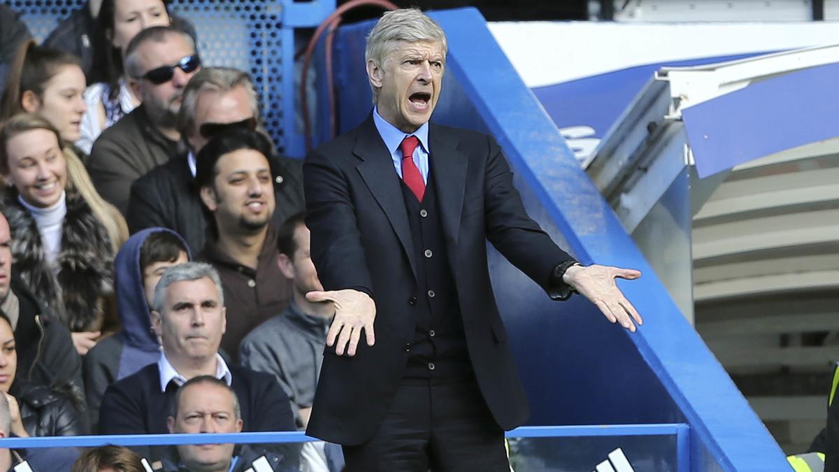 Arsène Wenger répond à Paul Scholes !